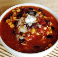 Slow Cooker Taco Soup: 1 lb. cooked meat of choice, 28 ounce can of crushed tomatoes (I used 1 can diced chili tomatoes, 1 can tomato sauce and filled each of them 1/2 way with extra water), 2 c frozen corn, one 15 ounce can black beans, one 15 oz can red kidney beans, 2 tbs Taco seasoning, black pepper, garlic salt, oregeno, garlic powder, 1 tsp beef granules, 1 small chopped onion, some chopped green, red, yellow peppers - Place all ingredients in a slow cooker on low 4-6 hours.