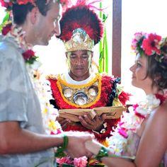 A traditionally dressed Polynesian priest leads the nuptials for a @Four Seasons Resort Bora Bora couple.