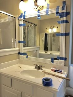 """How To DIY Frame Your Builder Grade Mirror,With a few cuts and some glue transform your mirrors! When you hear """"builder grade"""" you probably have the same yellow/beige color I'm thinking of come. Bathroom Mirrors Diy, Diy Bathroom Decor, Bathroom Colors, Master Bathroom, Bathroom Makeovers, Bathroom Ideas, Bathroom Trends, Glass Bathroom, Bathroom Organization"""