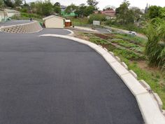Asphalt driveway and parking area with retaining wall system. Asphalt Driveway, Sidewalk, Country Roads, Wall, Side Walkway, Walkway, Walls, Walkways, Pavement