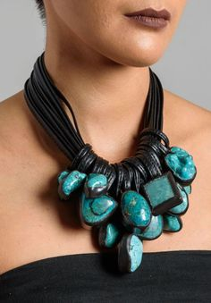$2,985.00 | Monies UNIQUE 14 Strand Turquoise Necklace | Monies jewelry is bold in design and strong in aesthetic. This Monies necklace is made with Turquoise, Copper, Leather, and Ebony, to become a one-of-a-kind and edgy statement piece. All pieces are handmade. Monies is sold online and in-store at Santa Fe Dry Goods & Workshop in Santa Fe, New Mexico.