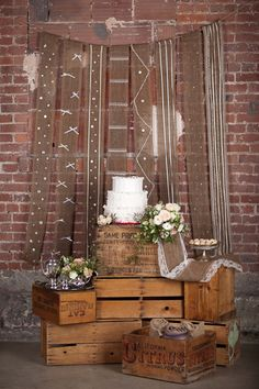 I like the idea of this. Burlap and lace strung up behind the cake table @nicolecortes - :)