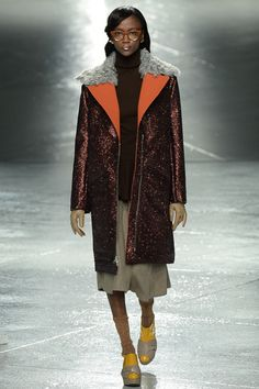 """Sparkly red coat with a partly grey fur collar and """"winter sandals"""" Rodarte 