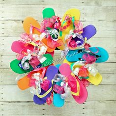 My own version of a DIY flip flop wreath / summer door hanging! I only bought 7 pair of $1 flip flops at Target - then I just used what I had on hand to make it!