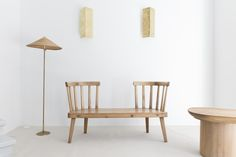 """Pair or sconces by Paavo Tynell - Floor Lamp by Paavo Tynell - Side Table """" UTO""""  by Axel Einar Hjorth - Sofa """" UTO"""" by Axel Einar Hjorth.  Photography by Kiwibravo"""