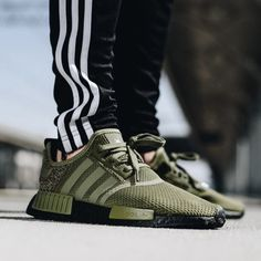 """7542d6d78f32c C R E P T O P I A on Instagram  """"Instead of a complete olive green takeover  the NMD boosts a black BOOST sole below the lighter-toned olive upper to  create ..."""