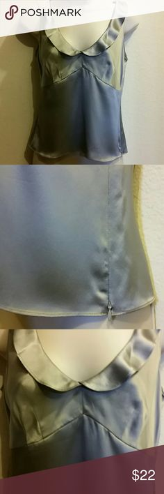 """J. Crew silk blouse This lovely medium silver silk blouse was worn only once. It has a few tiny spots on front (see pic 4) but I didnt even notice them until I inspected it closely. Measures 17.25"""" across chest, 14.5"""" waist then flares to 17"""" at bottom. Lenth is 19.5"""". Pairs nicely with a pencil skirt or high waisted dress slacks. There is a side zip. J. Crew Tops Blouses"""