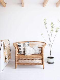rattan chair with printed throw pillows. / sfgirlbybay