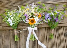 Rustic summer wedding bouquets, brides bouquet of sunflowers, stakes Daisy's and lavender mismatch bridesmaid bouquets.