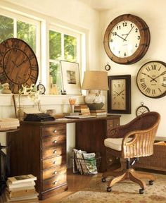 A little humor goes a long way in the home office. Here, we've used a collection of beautiful, functioning wall-mounted clocks to remind us of the virtue of easy-going efficiency. Soothing neutral tones, a window-facing view and a comfortable swiveling chair only add to the likelihood of time well spent.