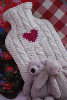 A striking heart design on a cable background, in a merino blend yarn has cashmere, which makes it ultra soft and warm. Water Bottle Covers, Cosy Winter, Crochet Decoration, Red Gingham, Warm Blankets, Winter Warmers, School Fun, Creative Inspiration, Warm And Cozy