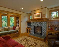 Neutral paint with oak trim, grey fireplace