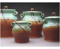 """Other ViewsEnlarge Cinnamon and Sage Pottery Canisters Celadon Wheat and Turquoise Cream and Sage """"Great kitchen match"""" 6/29/2011 By Beth Loved the canisters!! Just what I was looking for!! Thank you! Copper Handle Pottery Canister Set"""