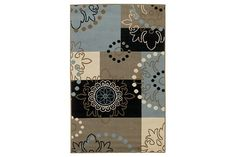 With its fanciful scrolled emblems and flirty dotted accents, the Vito rug definitely vetoes a boring approach to design. Pretty embellishments are grounded by geographic planes that give weight and balance. The brown-blue color medley is always in fashion.