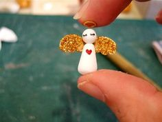 Tutorial courtesy of Meiwei Huang. Things you need: craft wire, some paper, paper clay, acrylic paint, glitters, craft glue, wire cutter, round nose pliers, scissors. Step 1: Make a loop with craft…