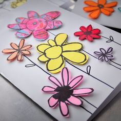 Cute easy way to make greeting cards out of paper scraps. They're full of hand drawn flowers.