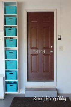 Garage Project: I like the idea of bins by the door.