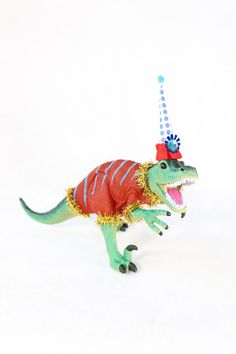 """Party Dinosaur """"Dale"""" painted birthday and room decor. By PaintedParade, $22.00. Perfect for a cake topper for dinosaur party, or as a table decoration."""