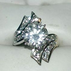 4 carat diamond engagement ring set in 14k yellow gold.