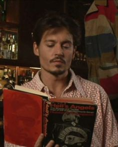 Johnny Depp reading Hell's Angels by Hunter S. Thompson. (I had to include Johnny somehow.)