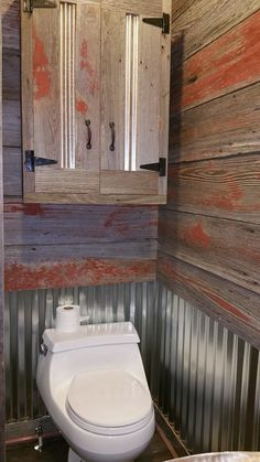 Rustic Bathroom.Reclaimed barn siding and galvanized steel bathroom storage cabinet.