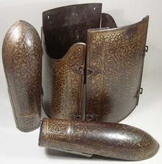Indian dastana/bazu band (arm guards) and char-aina (chahar-aina, chahar a'ineh). Literally the four mirrors. Four plates worn over a zirah (shirt of mail) in Persia, India and Central Asia. The armor plates can be rectangular or round, and the two plates worn on the breast and back are considerably larger than those worn at the sides which had recesses for the arms. During the 16th century, chahar aina cuirasses were introduced in Iran.