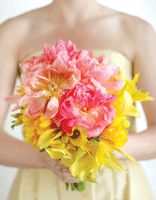Grow With Us: Pink peonies, calla lilies, freesia and feathers. 837-9449