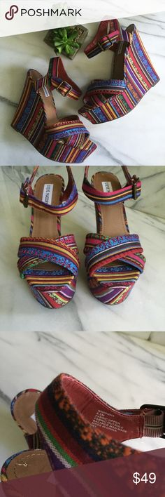 "Steve Madden Winonna Aztec Sandal Wedge Size 8.5 Steve Madden Winonna Aztec Sandal Wedge. Size 8.5. Adjustable ankle strap with buckle closure and elastic inset. Heel height is approximately 5"" with 2"" platform. Textile upper. Synthetic lining and sole. Excellent condition. Steve Madden Shoes Wedges"