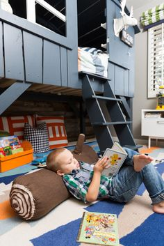 Custom Lofted Toddler Bed - love the reading nook space underneath!