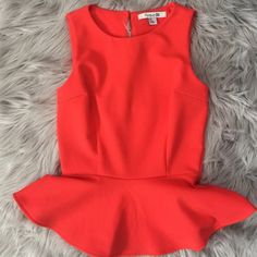 Final Price! Forever 21 Peplum Top Bright Coral colored peplum top from forever 21 size small!  Cute keyhole back detail.  Worn once! Price is firm for this  Forever 21 Tops Tank Tops
