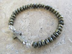 Pyrite, Crystal, Karen Hill Tribe Silver and Pyrite Cross Stretch Bracelet by RadMadeJewellery on Etsy https://www.etsy.com/listing/257558368/pyrite-crystal-karen-hill-tribe-silver