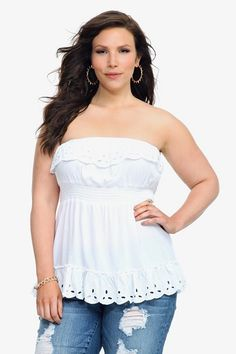 e16af433285d7a Embroidered cutout detailing on the ruffle trim lends flirty flair to this  white strapless top.