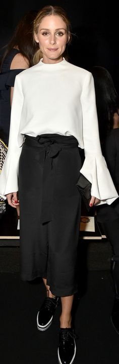 Who made Olivia Palermo's black pants and white long sleeve top?