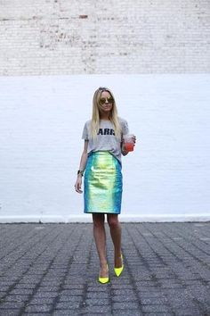 Fall Outfit Inspiration: Metallic Trend. Metallic iridescent green pencil skirt work with neon yellow heels and a graphic tee.