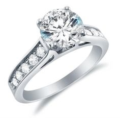 Size 7 - Solid 14k White Gold Round Brilliant Cut Solitaire with Round Side Stones Highest Quality CZ Cubic Zirconia Engagement Ring 1.75ct. Sonia Jewels http://www.amazon.com/dp/B005EW4QZO/ref=cm_sw_r_pi_dp_PRc-tb01NWDW2