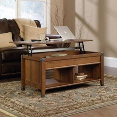 This versatile and unique Lift-Top Coffee Table from the Sauder, Carson Forge collection is a wonderful multi-use piece of lovely living room/den furniture. The Washington Cherry Finish is perfect for any color of room decor. Lift Top Coffee Table, Cool Coffee Tables, Coffee Table With Storage, Table Storage, Storage Benches, Coffee Table That Raises Up, Storage Area, Storage Room, Storage Chest