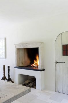 My dream home features a kitchen fireplace that looks like this. Build A Fireplace, Fireplace Design, Fireplace In Kitchen, Open Fireplace, Stucco Fireplace, Fireplace Shelves, Concrete Fireplace, Home Design, Design Ideas