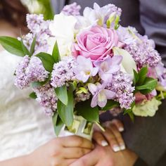 Lavender lilacs soft purple roses & freesia...yes please!  Floral Design: @allgrandevents by allgrandevents