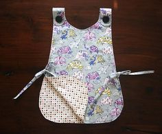 I made mine with a plastic fabric and backed it with a cotton blend.  Added a pocket to the front.