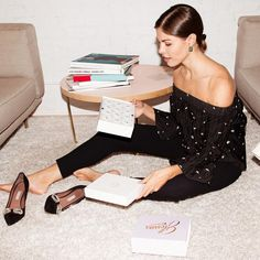 Emily Weiss - off-shoulder black blouse and black jeans and shoes