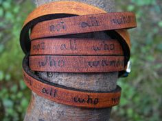 Ultra Long Hand Carved Custom Quote Leather Wrap Bracelet - $29.00, via Etsy. Note: Black for him, turquoise or tan for me.