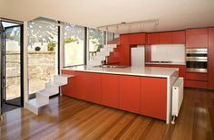 Red kitchen stairs, note the bench top...