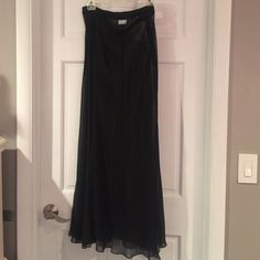 Long Sheer Skirt A gorgeous dressy sheer long skirt from DKNY. Black. Side zipper. Length is approximately 41 inches and waist is 30 inches. Size 12 DKNY Skirts Maxi