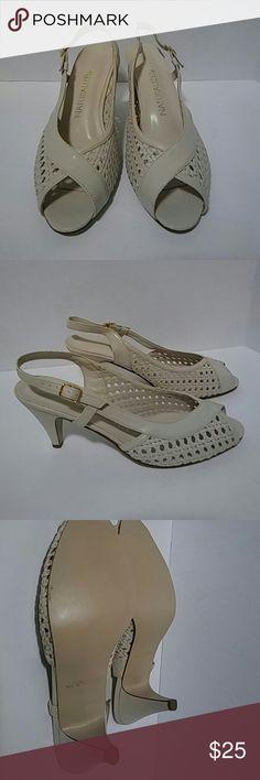 Light cream colored heels Very light wear. Naturalizer brand.  3.5 inch heel. Naturalizer Shoes Heels