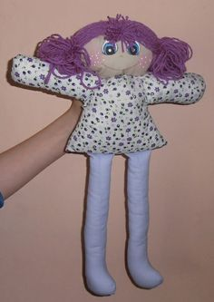 The doll made ​​of cotton fabric.In the middle of the soft contribution cushion.Hair of wool.Painted face paint for fabrics.Height about 42 cm