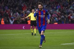 Barcelona's Argentinian forward Lionel Messi celebrates after scoring a goal during the Spanish league football match FC Barcelona vs Sevilla CF at the Camp Nou stadium in Barcelona on April 5, 2017. / AFP PHOTO / Josep LAGO