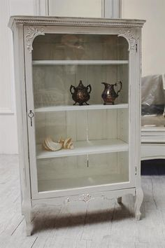 Like the contrast with all the brown plans.  This will be for hubby's model cars and hot wheels.  ❥ Vintage Carved Flowers Curio Display Cabinet