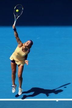 Victoria Azarenka of Belarus serves in her third round match against Jamie Hampton of the United States during day six of the 2013 Australian Open at Melbourne Park on January 2013 in Melbourne, Australia. Australian Open, Opening Day, Sports Photos, Winter Olympics, Melbourne Australia, Tennis Players, Winter Sports, Tennis Racket, Ballet Dance