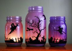 love these painted mason jars.very cool looking for Halloween! Halloween Mason Jars - Ideas for Using Mason Jars for Halloween - Country Living Casa Halloween, Halloween Projects, Holidays Halloween, Happy Halloween, Halloween Party, Halloween Candles, Halloween Graveyard, Diy Halloween Mason Jars, Purple Halloween Decorations