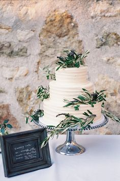 #WeddingCake with olive branches and lavender | Photography by Leah | Brides.com